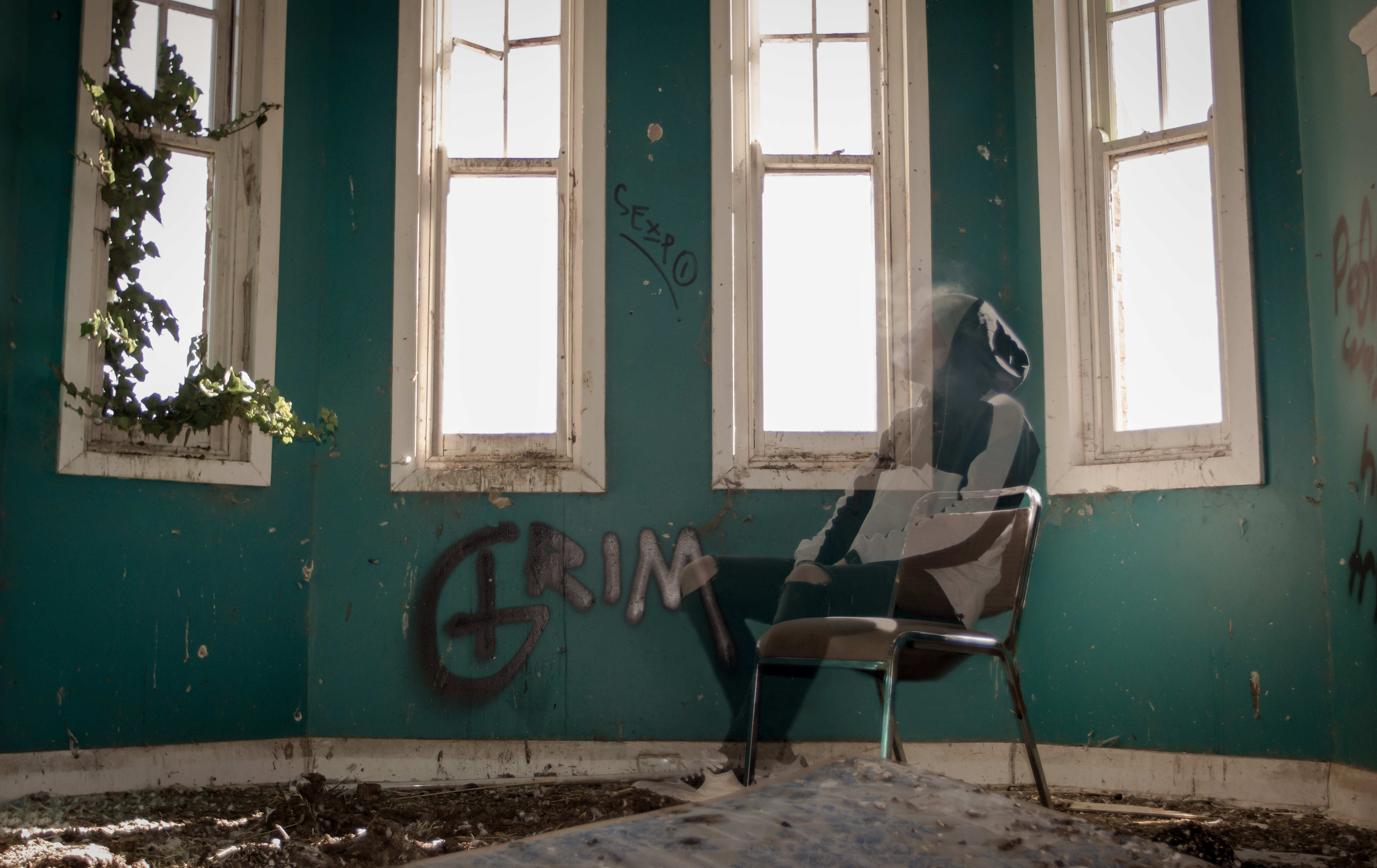 Ghost sitting on chair in empty room. Photograph by kind permission of Corey McAloon. Instagram: coreymcaloon